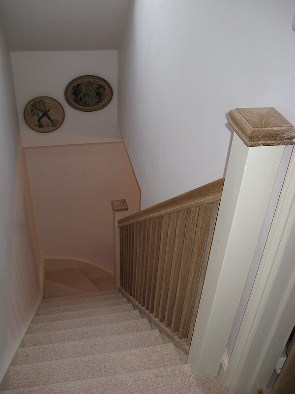 This softwood winder staircase was for a loft conversion. It has an all oak balustrade.